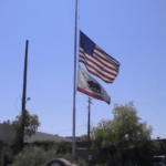 The US and California flags fly at half mast in a tragedy.