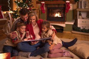 family reading together during the holidays
